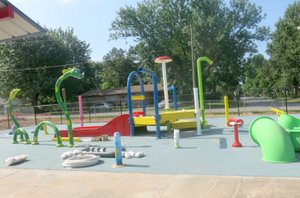 Westside Eagle Observer/SUSAN HOLLAND New playground equipment is nearing completion at the Gravette aquatic park. The water park, pavilions and waterslide await use by youngsters when the park opens at 1 p.m. Friday, June 15. Pool admission is $3, or $1.50 from 5 to 7 p.m.