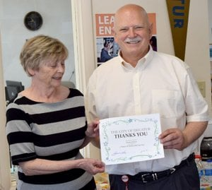 Westside Eagle Observer/MIKE ECKELS Karen Jones (left) receives a certificate of appreciation reward from Mayor Bob Tharp June 6 for her six years of service as the head librarian at the Iva Jane Peek Library in Decatur.
