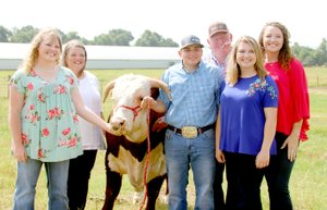 LYNN KUTTER ENTERPRISE-LEADER Jerry and Dyanna Moyer and their two daughters, Cheyenne and Caleigh, are the 2018 Washington County Farm Family of the Year. They are pictured above with two others they consider part of their extended family, niece Dixie Miller and friend Paul Cole. See next week's Enterprise-Leader for more information on the Moyers and their poultry and cattle farm in Lincoln.