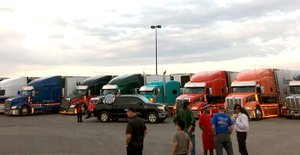 Stephanie Freeman/Special to the Herald-Leader Riders and drivers converse in a parking lot in Albuquerque, N.M.