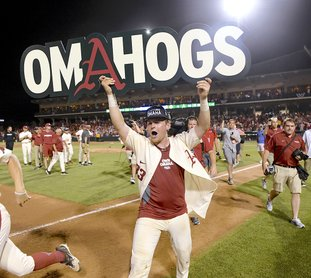 The Associated Press #OMAHOGS: Arkansas junior catcher Grant Koch celebrates after the Razorbacks' 14-4 victory Monday over South Carolina to win the Fayetteville Super Regional at Baum Stadium. The Razorbacks will meet the Texas Longhorns on Sunday at the College World Series in Omaha, Neb.