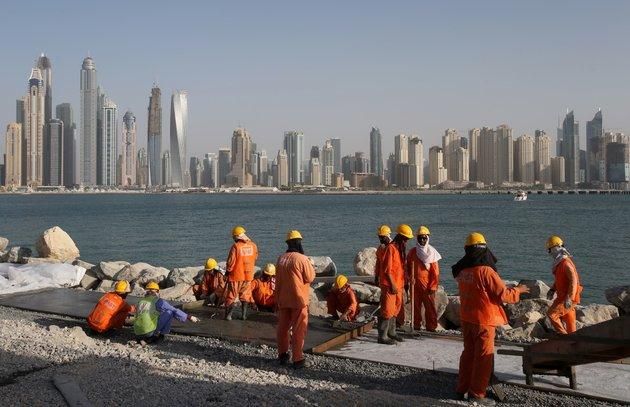 laborers-work-at-a-construction-site-in-dubai-united-arab-emirates-in-this-2015-file-photo-a-report-by-the-washington-based-center-for-advanced-defense-studies-says-dubais-secretive-and-booming-real-estate-market-is-used-to-hide-assets