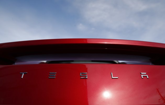 file-in-this-april-15-2018-file-photo-the-sun-shines-off-the-rear-deck-of-a-roadster-on-a-tesla-dealers-lot-in-the-south-denver-suburb-of-littleton-colo-ap-photodavid-zalubowski-file