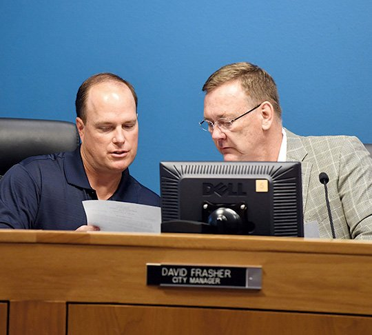 the-sentinel-recordgrace-brown-resignation-tendered-assistant-city-mangercity-clerk-lance-spicer-left-speaks-with-city-manager-david-frasher-tuesday-at-city-hall-the-board-later-convened-an-executive-session-and-accepted-frashers-resignation