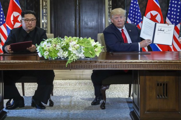 us-president-donald-trump-holds-up-the-document-that-he-and-north-korea-leader-kim-jong-un-just-signed-at-the-capella-resort-on-sentosa-island-tuesday-june-12-2018-in-singapore-the-most-tangible-outcome-of-the-summit-between-president-donald-trump-and-north-korean-leader-kim-jong-un-seems-to-be-a-commitment-to-recover-the-remains-of-us-military-personnel-missing-in-action-and-presumed-dead-from-the-korean-war-in-a-joint-statement-signed-by-the-leaders-tuesday-the-countries-committed-to-the-recovery-of-the-remains-and-the-immediate-repatriation-of-those-already-identified-ap-photoevan-vucci