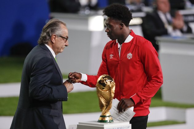 decio-de-maria-president-of-the-football-association-of-mexico-left-and-canadian-soccer-player-alphonso-davies-right-present-a-joint-united-bid-by-canada-mexico-and-the-united-states-to-host-the-2026-world-cup-at-the-fifa-congress-in-moscow-russia-wednesday-june-13-2018-ap-photopavel-golovkin