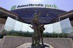 """The statue """"The Road to Omaha"""" stands at the entrance to TD Ameritrade Park, home of the NCAA baseball College World Series, in Omaha, Neb. (AP Photo/Nati Harnik)"""