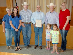 Members of the Siloam Springs Riding Club met at City Hall on Monday morning as Mayor John Mark Turner issued a proclamation declaring June 14-16 as Siloam Springs Rodeo Days. Pictured, from left, are Siloam Springs Riding Club members Karen Davis, Kari Hutchins, Jeff Lee, Turner, Dean Miller with Scarlett Thompson and Abigail Carnes in front, and Kaci Johnson.