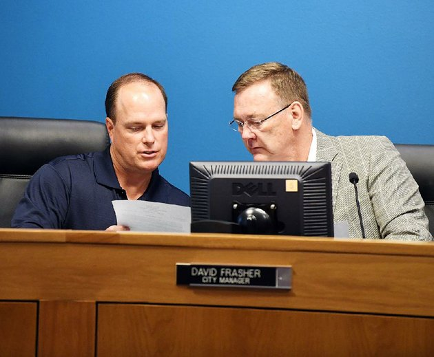 hot-springs-assistant-city-manager-lance-spicer-left-confers-with-city-manager-david-frasher-before-a-board-meeting-tuesday-night-at-city-hall-frasher-resigned-during-the-meeting-after-allegations-were-aired-that-he-made-a-racially-insensitive-remark-to-a-black-hot-springs-school-district-administrator-last-week