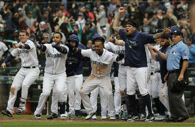 seattle-players-wait-for-mitch-haniger-at-home-plate-after-he-hit-a-game-winning-two-run-home-run-in-the-ninth-inning-wednesday-in-the-mariners-8-6-victory-over-the-los-angeles-angels