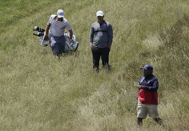 defending-us-open-champion-brooks-koepka-center-lines-up-a-shot-from-the-rough-along-the-ninth-fairway-during-a-practice-round-earlier-this-week-at-shinnecock-hills-golf-club-where-the-us-open-begins-today-the-last-time-the-open-was-held-at-the-new-york-course-in-2004-only-three-players-broke-par-for-the-weekend