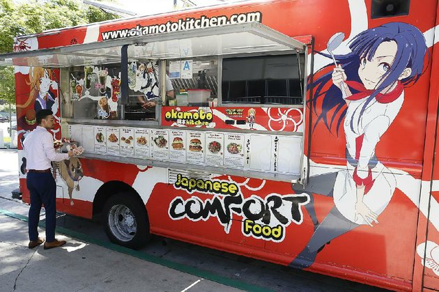 a-customer-waits-in-line-at-the-okamoto-kitchen-food-truck-in-beverly-hills-calif-owners-gerald-and-chizuru-abraham-say-food-trucks-are-no-longer-a-novelty-in-big-cities-and-they-have-to-think-creatively-for-their-business-to-thrive