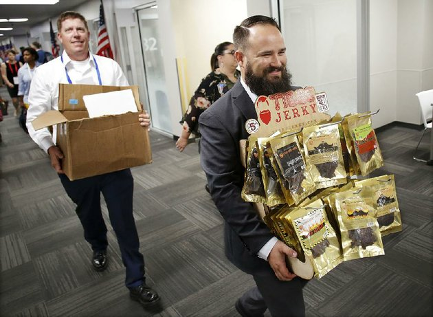 steven-tibbs-front-owner-of-tibbs-jerky-carries-a-display-of-his-products-down-vendor-hall-at-walmarts-made-in-america-open-call-event-in-bentonville-on-wednesday-behind-him-is-ben-ebenhoe-tibbs-jerkys-sales-executive-and-chief-financial-officer