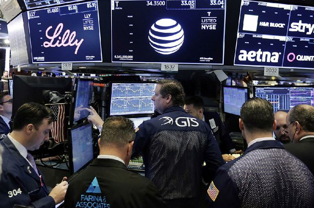 specialist-gregg-maloney-center-works-with-a-trader-wednesday-at-the-post-that-handles-att-and-walt-disney-shares-at-the-new-york-stock-exchange-disney-stock-was-up-slightly-as-comcasts-continued-to-sag-as-both-pursued-21st-century-fox-properties