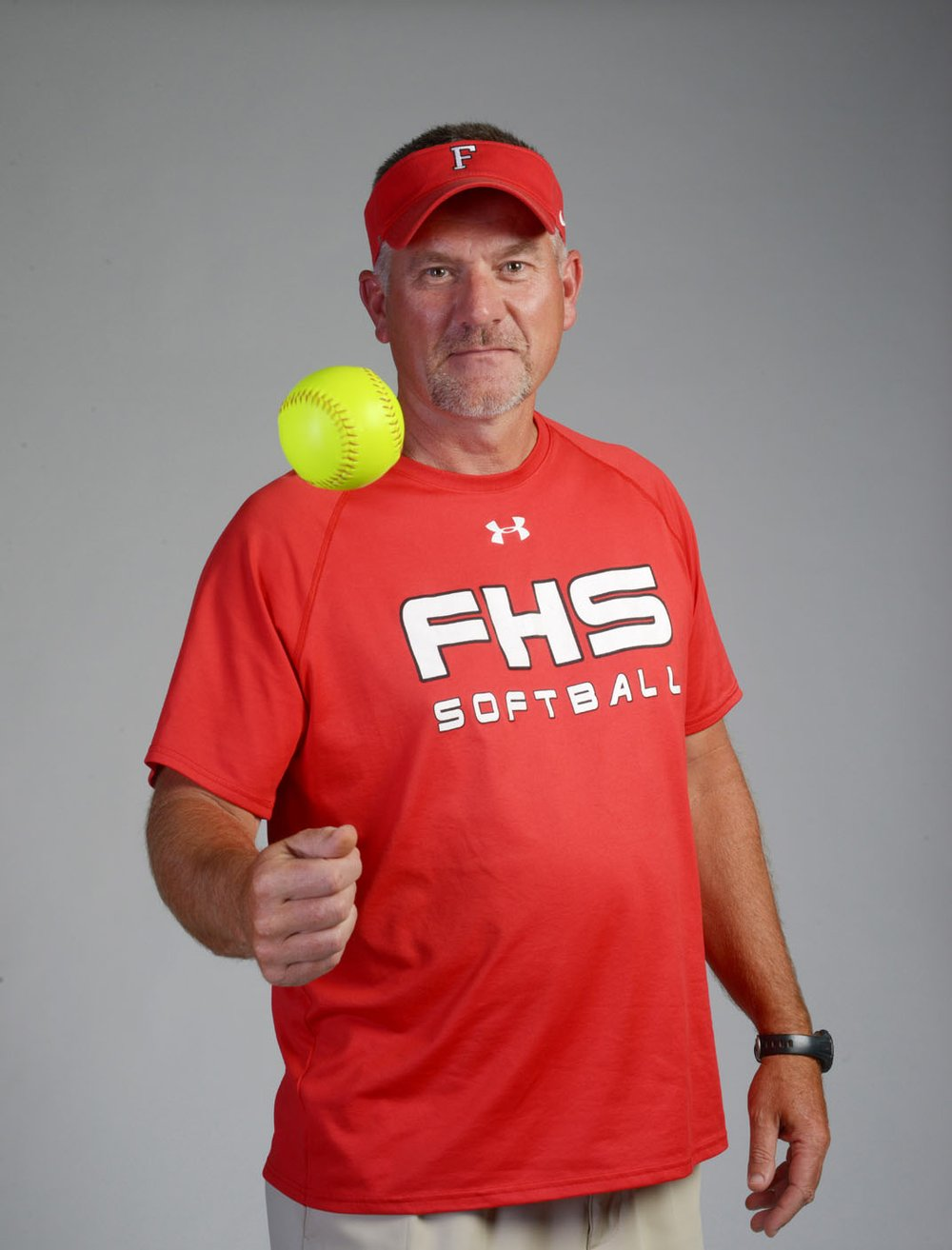 NWA Democrat-Gazette/SPENCER TIREY Randy Osnes of Farmington is the NWADG Division I Softball Coach of the Year.