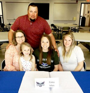 Courtesy photo Coley Ickes (center) celebrates her signing ceremony at a special event in May at Crowder College. The point guard will join the Oklahoma Wesleyan University women's college basketball team. Ickes' family was on hand to cheer her on, including her dad, Darryl; her mom, Shelly; with Ickes' niece, Rilynn Crain; and her sister, Kirstie Crain.