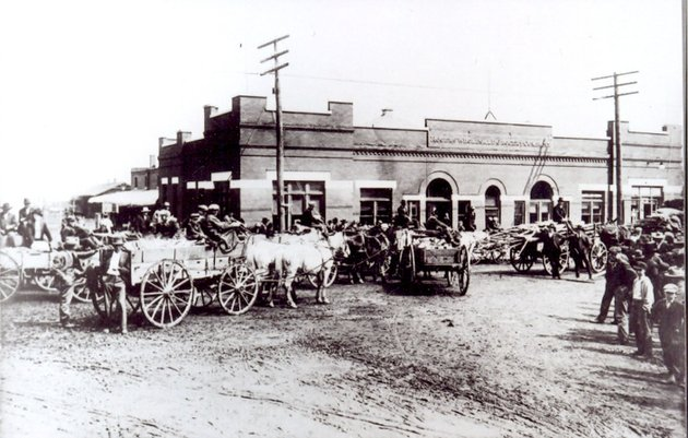 photo-courtesy-of-the-rogers-historical-museum-local-residents-brought-wood-on-saturday-to-sell-in-front-of-the-rogers-wholesale-grocery-about-1910-note-there-is-not-a-single-female-in-the-picture-before-the-days-of-the-big-chain-groceries-there-was-a-mom-and-pop-grocery-on-every-corner-rogers-wholesale-supplied-merchandise-to-these-stores
