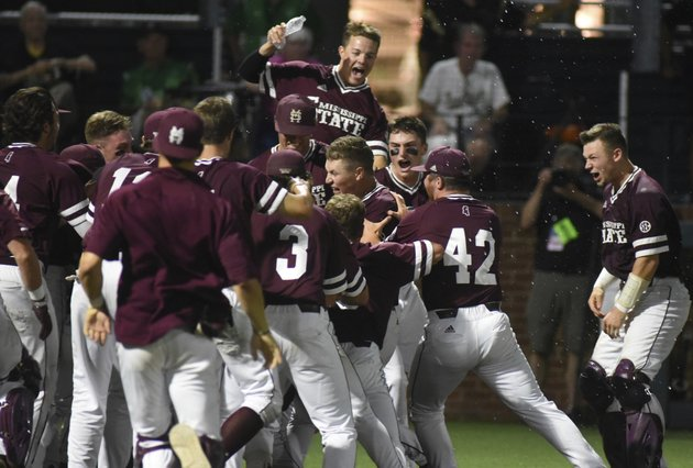 mississippi-states-elijah-macnamee-is-swarmed-at-home-after-hitting-a-two-run-home-run-in-the-ninth-inning-for-a-10-8-win-over-vanderbilt-in-an-ncaa-college-baseball-super-regional-game-friday-june-8-2018-in-nashville-tenn-ap-photomike-strasinger