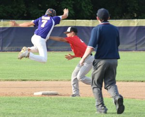 RICK PECK/SPECIAL TO MCDONALD COUNTY PRESS McDonald County second baseman Josh Parsons tags out a Monett runner during McDonald County's 7-3 loss to Monett on June 12 in Monett.