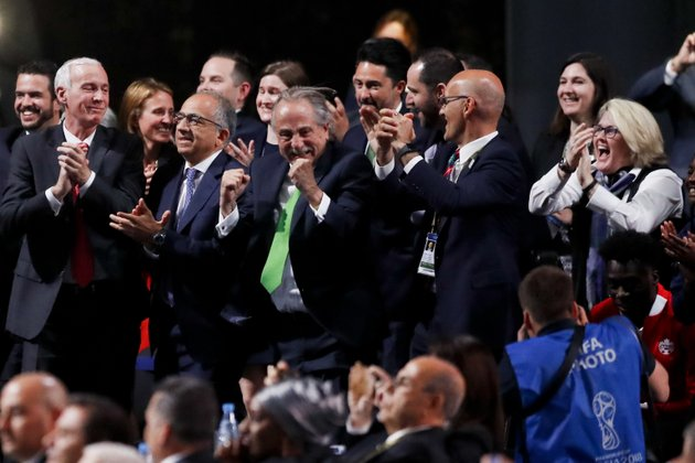 delegates-of-canada-mexico-and-the-united-states-celebrate-after-winning-a-joint-bid-to-host-the-2026-world-cup-at-the-fifa-congress-in-moscow-russia-wednesday-june-13-2018-standing-on-front-row-from-left-steve-reed-president-of-the-canadian-soccer-association-carlos-cordeiro-us-soccer-president-and-decio-de-maria-president-of-the-football-association-of-mexico-ap-photopavel-golovkin