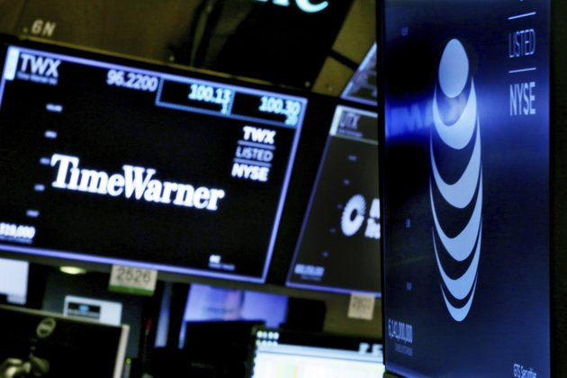 the-logos-for-time-warner-and-att-appear-above-alternate-trading-posts-on-the-floor-of-the-new-york-stock-exchange-wednesday-june-13-2018-ap-photorichard-drew