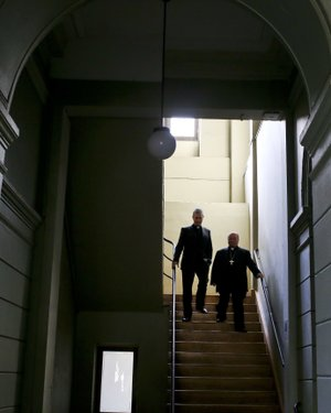 Archbishop Charles Scicluna, right, and Spanish Monsignor Jordi Bertomeuof, walk down a set of stairs prior a press conference at the Catholic University of Chile, in Santiago, Chile, Wednesday, June 13, 2018.  (AP Photo/Esteban Felix)