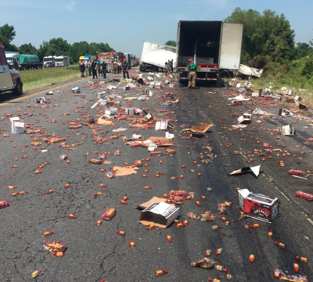 this-photo-posted-on-the-arkansas-department-of-transportation-twitter-account-shows-a-wreck-on-i-40-that-caused-whiskey-to-spill-across-the-highway-on-thursday-morning