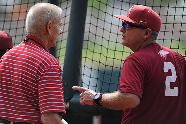 former-arkansas-baseball-coach-norm-debriyn-left-speaks-with-coach-dave-van-horn-thursday-june-1-2017-during-practice-at-baum-stadium-in-fayetteville-teams-spent-the-day-practicing-ahead-of-todays-opening-round-of-games-in-the-ncaa-fayetteville-regional-baseball-tournament