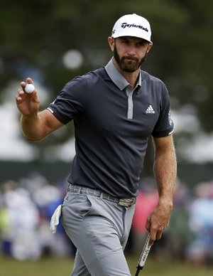 Dustin Johnson reacts after making a putt for birdie on the fourth green during the second round of the U.S. Open Golf Championship, Friday, June 15, 2018, in Southampton, N.Y.