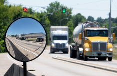 Commercial trucks pass ...