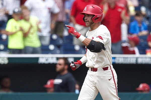 Arkansas designated hitter Luke Bonfield rounds the bases after hitting a home run during the fifth inning of a College World Series game against Texas on Sunday, June 17, 2018, in Omaha, Neb.