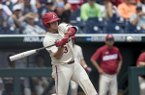 Arkansas catcher Grant Koch swings during a College World Series game against Texas on Sunday, June 17, 2018, in Omaha, Neb.