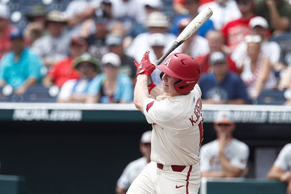 Arkansas outfielder Heston Kjerstad hits an RBI single during the first inning of a College World Series game against Texas on Sunday, June 17, 2018, in Omaha, Neb.