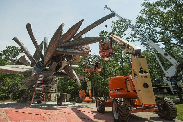 a-crew-installs-the-sculpture-monochrome-ii-by-nancy-rubins-on-june-7-on-the-north-forest-trail-at-crystal-bridges-museum-of-american-art-in-bentonville-the-sculpture-is-fabricated-from-aluminum-canoes-and-jon-boats