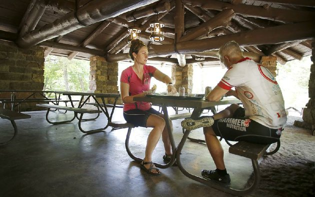 crystal-and-don-day-of-lincoln-neb-eat-lunch-last-week-in-the-outdoor-dining-area-of-the-ridge-runner-store-and-cafe-at-devils-den-state-park-a-portion-of-the-building-was-destroyed-by-a-fire-in-2015-but-reopened-this-march