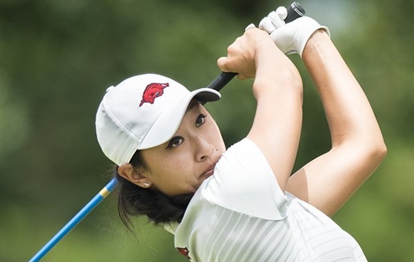 Razorbacks golfer Dylan Kim swings during a qualifier to get into the LPGA tournament this week, Monday, June 18, 2018 at the Pinnacle Country Club in Rogers.