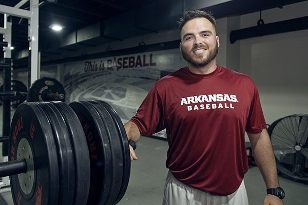 Blaine Kinsley, Arkansas's new assistant strength and conditioning coach for baseball, poses Thursday, Sept. 21, 2017, at the Arkansas baseball practice facility in Fayetteville.