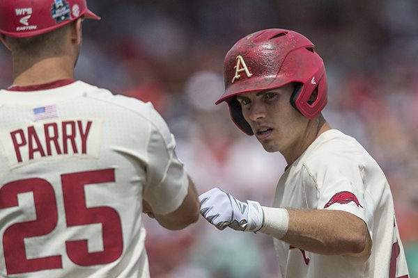 Carson Shaddy, Arkansas second baseman, hits a single in the 6th inning vs Texas Sunday, June 17, 2018, during game three of the NCAA Men's College World Series at TD Ameritrade Park in Omaha.