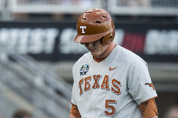 Ryan Reynolds of Texas walks off after striking out in the 7th inning against Arkansas Sunday, June 17, 2018, during game three of the NCAA Men's College World Series at TD Ameritrade Park in Omaha.