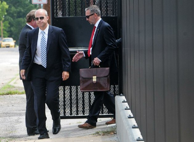 former-state-sen-jake-files-left-walks-through-the-back-parking-lot-gate-monday-at-the-judge-isaac-c-parker-federal-building-in-fort-smith-after-being-sentenced-to-18-months-in-federal-prison-on-wire-fraud-bank-fraud-and-money-laundering-charges