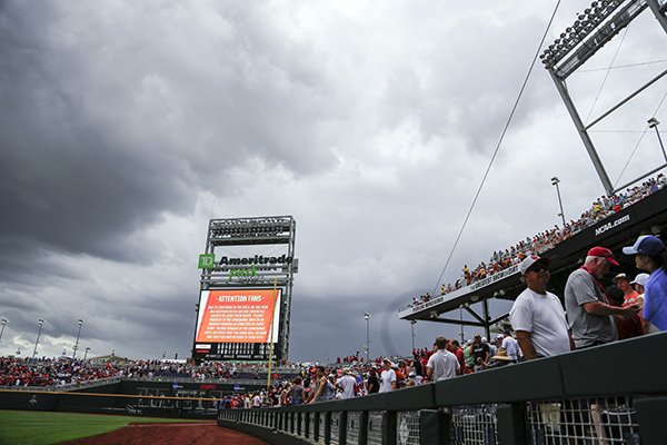 Heavy clouds hang over TD Ameritrade Park as the threat of thunderstorms causes a weather delay in the sixth inning of an NCAA College World Series baseball game between Texas and Arkansas, in Omaha, Neb., Sunday, June 17, 2018. (AP Photo/Nati Harnik)