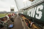 The Arkansas dugout is shown after a College World Series game between the Razorbacks and Texas Tech was postponed Tuesday, June 19, 2018, in Omaha, Neb.
