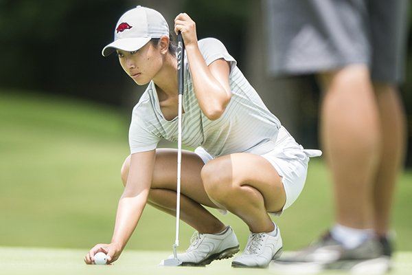 NWA Democrat-Gazette/CHARLIE KAIJO Razorbacks golfer Dylan Kim prepares to putt during a qualifier to get into the LPGA tournament this week, Monday, June 18, 2018 at the Pinnacle Country Club in Rogers.
