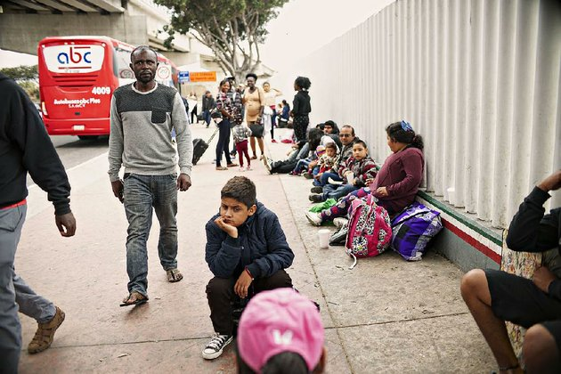 people-wait-for-asylum-hearings-tuesday-outside-the-us-port-of-entry-in-tijuana-mexico-as-us-officials-considered-changes-in-immigration-law