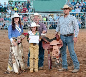 Janelle Jessen/Herald-Leader Brooklyn Teague, 10, of Siloam Springs, was crowned rodeo princess by 2017 Rodeo Queen Brittney Doshier on Saturday evening.