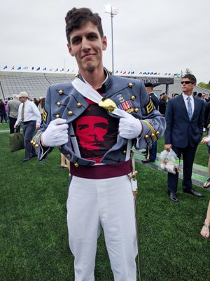 Spenser Rapone shows off his Che Guevara T-shirt underneath his uniform after he graduated from the United States Military Academy in May 2016.