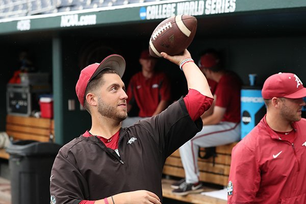 arkansas-pitcher-kacey-murphy-throws-a-football-during-a-rain-delay-wednesday-june-20-2018-at-the-college-world-series-in-omaha-neb