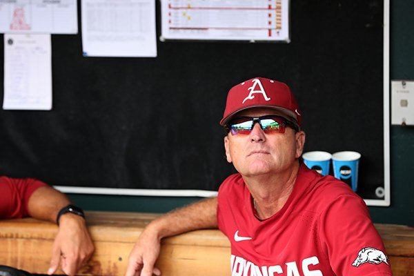 Arkansas coach Dave Van Horn watches from the dugout during a rain delay prior to a College World Series game against Texas Tech on Wednesday, June 20, 2018, in Omaha, Neb.