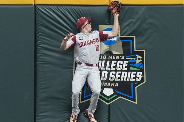 Arkansas outfielder Heston Kjerstad makes a catch at the wall during the second inning of a College World Series game against Texas Tech on Wednesday, June 20, 2018, in Omaha, Neb.