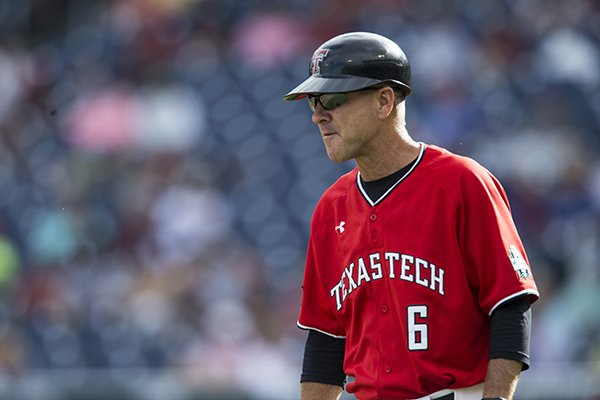 Texas Tech coach Tim Tadlock watches during a College World Series game against Arkansas on Wednesday, June 20, 2018, in Omaha, Neb.